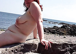 Red-hot haired granny got banged not susceptible an obstacle beach, waiting for she came