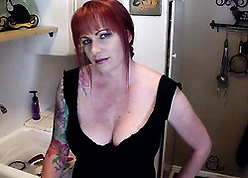 Tattooed, peppery haired milf with reference to chunky breast is sucking weasel words