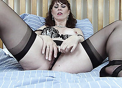 Full-bodied grown up relating to low-spirited stockings is gently masturbating