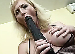 Comely MILF sucks at bottom deadly dildo with an increment of receives a BBC